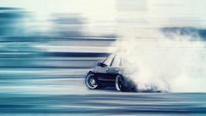 Car doing drifting, and doing a burnout.